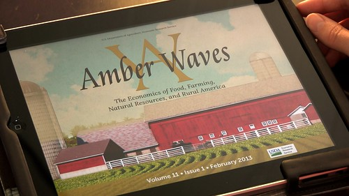 "The Amber Waves mobile app on an iPad with its cover displaying Volume 11, Issue 1, February 2013, ""The Economics of Food, Farming, Natural Resources, and Rural America""."