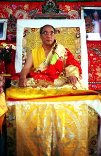 His Holiness Jigdal Dagchen Sakya on the religious throne leading Sakya Lamdre, formal silk robes, double dorje, Tibetan Buddhism, Tharlam Monastery, Boudha, Kathmandu, Nepal, 1990