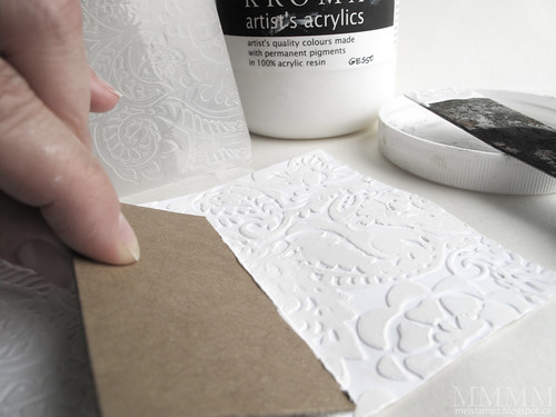 swipe embossed cardstock with gesso or paint