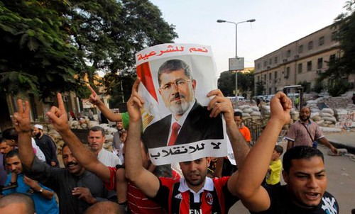 Egyptian pro-Morsi demonstration on Aug. 10, 2013. The military-backed regime has ordered the protesters off the streets within twenty-four hours. by Pan-African News Wire File Photos