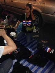 Selling t shirts at Thai protests on Bangkok at the democracy monument