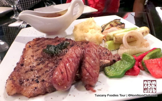 Dow Jones - US T-bone with prawns, potato wedges, sausages, and roasted vegetables