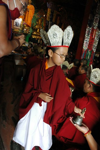 Crowned Tibetan Prince: wearing a 5 Dhyani Buddhas crown, HE Asanga Sakya giving the bell blessing during Tibetan Buddhist initiation, Sakya Lam Dre, Tharlam Monastery, Boudha, Kathmandu, Nepal by Wonderlane