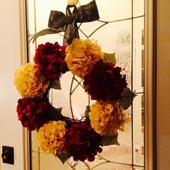 decor(0.0), plant(0.0), centrepiece(0.0), flower bouquet(0.0), art(1.0), flower arranging(1.0), flower(1.0), yellow(1.0), floral design(1.0), red(1.0), floristry(1.0), wreath(1.0), petal(1.0),