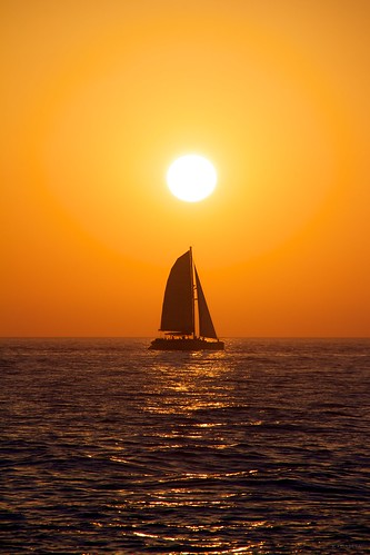 sunset orange water sailboat boat waves florida sail keywest sunsailing