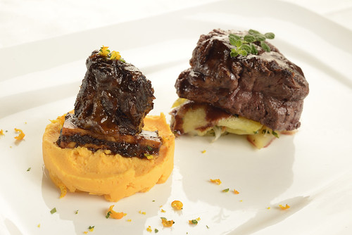 Grilled Beef Tenderloin with Sweet Potato Mash and Braised Short Rib in an Orange Balsamic Reduction