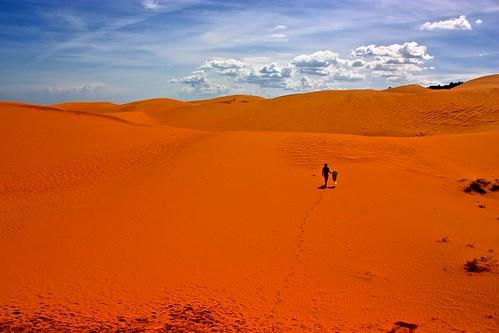 Me walking across the red sand dunes with my sled