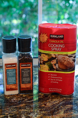 Containers of salt, pepper, and cooking spray.
