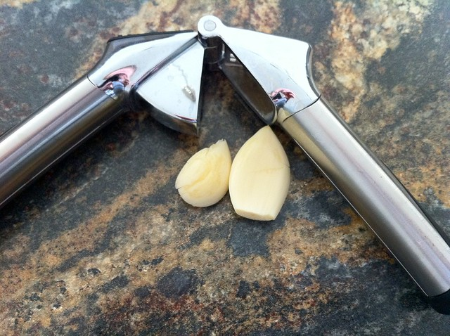 2 Cloves of Garlic with Garlic Press