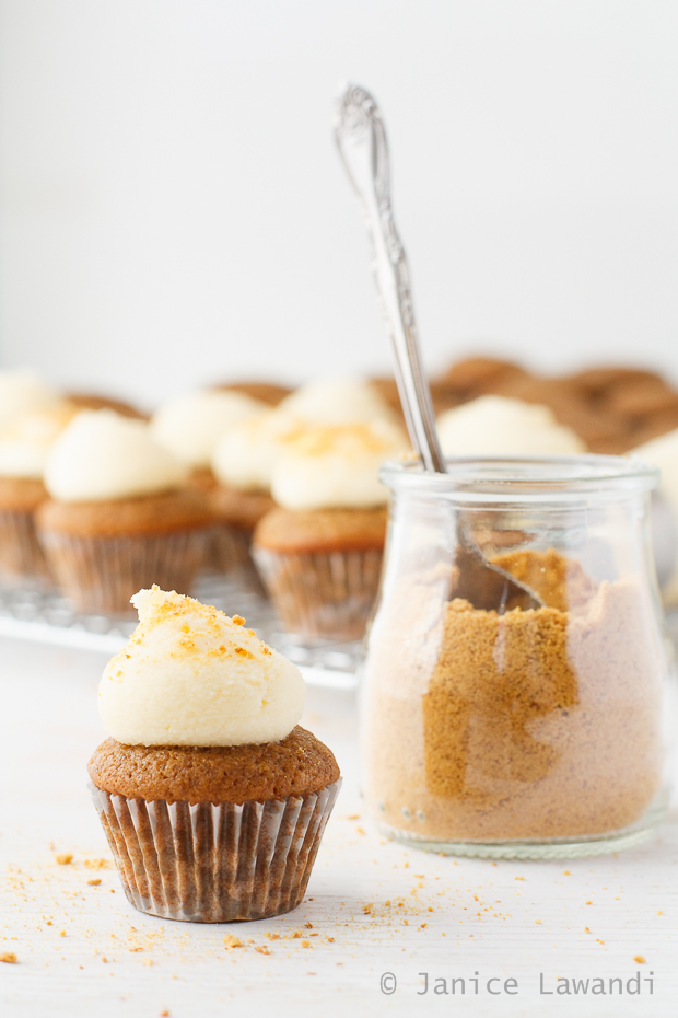 apple spice cupcakes with cream cheese frosting and topped with a sprinkling of graham cracker crumbs