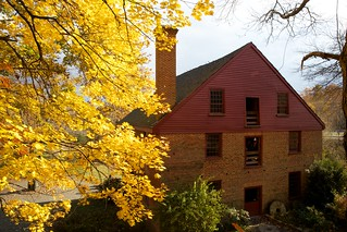 Image of Colvin Run Mill. autumn red building brick fall mill colors yellow virginia greatfalls historic gristmill colvinrun fairfaxcounty