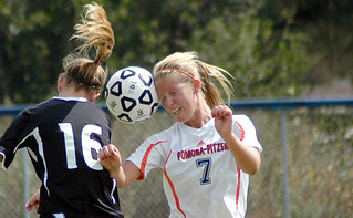 Sagehen Charlotte Fisken '14 almost literally butts heads with an opponent during a women's soccer match