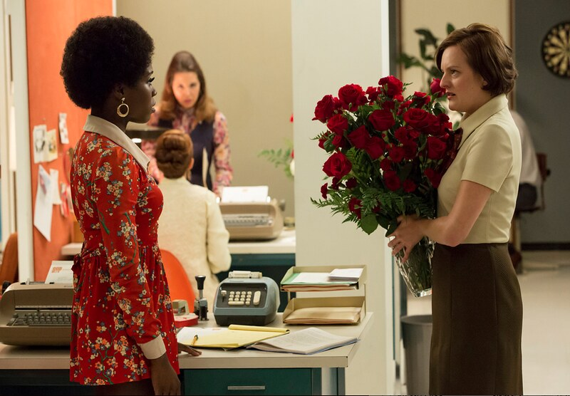 Shirley and Peggy discuss the huge bouquet of roses