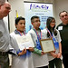 James H. Rodriguez Elementary School students Danny Serrano (second from left), José Olivas and Angel Valdez with their teacher, Jimmy Lara (right), and Laboratory volunteer Mark Bibeault during the Future City regional finals in Albuquerque.