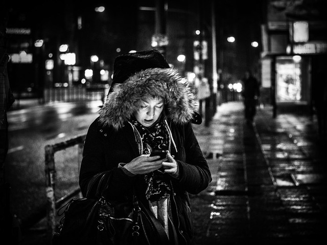 Woman with Mobile Phone; Night