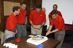 STS-109 crew members at cake cutting ceremony
