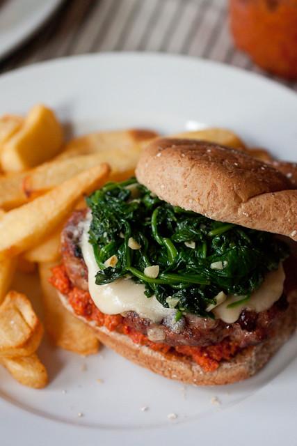 Sausage Burgers with Garlicky Spinach and Sun-dried Tomato Pesto