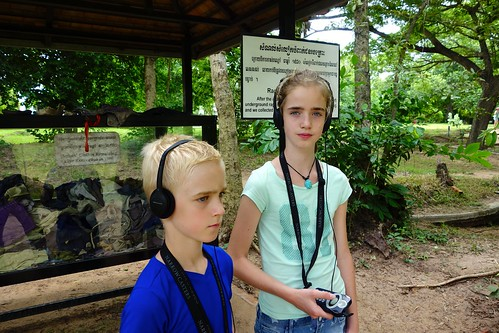 Listening to audio guide at Killing Fields