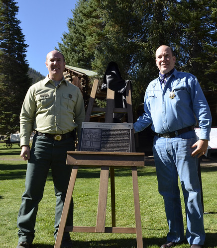 Shoshone Forest Supervisor Joe Alexander (left) and Prince Albert II of Monaco stand by the plaque commemorating Prince Albert I's original trip and the centennial celebration ride. (U.S. Forest Service/ Kristie Salzmann)