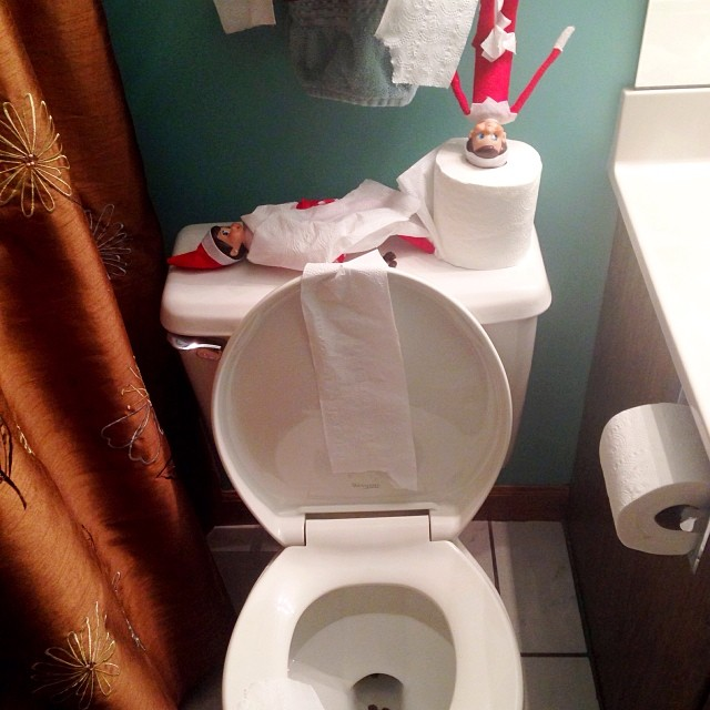 The elves must have had full bellies from toooo many cookies, because the kids found them in their bathroom like this!! Raisins in the potty and outside it, too and they has wayyy too much fun with the toilet paper. This produced lots of giggles from the