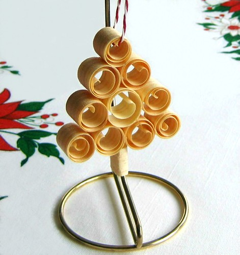 tree-shaped wood shaving Christmas ornament hanging on metal display