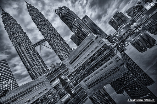 park christmas street plaza city morning sky urban lake holiday reflection building tree fountain monochrome retail architecture clouds skyscraper mall tia shopping season square landscape pond asia december cityscape angle cloudy centre capital petronas towers perspective twin overcast skybridge center icon structure business international commercial malaysia kualalumpur southeast tilt kl klcc dominance imposing christmastime suria attraction towering tilting jalanampang predominance tosinarasi tiascapes ©tiainternationalphotography