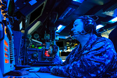 Fire Controlman 2nd Class Lauren Belt, foreground, and Fire Controlman 1st Class Edwin Falcis, both assigned to the guided-missile cruiser USS Shiloh (CG 67), monitor their consoles during a Fleet Synthetic Trainer-Joint (FST-J) Ballistic Missile Defense exercise aboard the ship. (U.S. Navy photo by Fire Controlman 2nd Class Kristopher G. Horton)