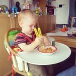 George using his training chopsticks