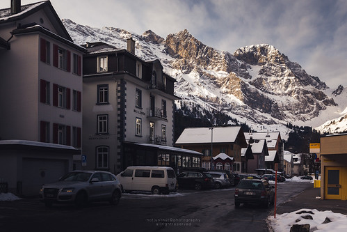 city winter sky house mountain snow home car landscape switzerland town swiss mountainview engelberg mountainrange titlis obwalden