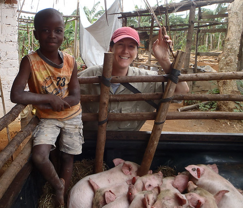 ILRI joint appointee scientist Natalie Carter and the son of a smallholder pig farmer in Uganda