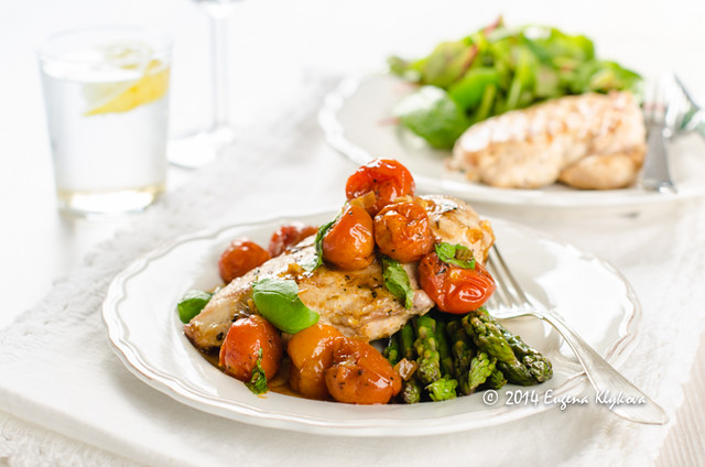 Grilled chicken with roasted tomato sauce and asparagus