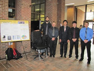 Variable Height Assist Chair Team with poster