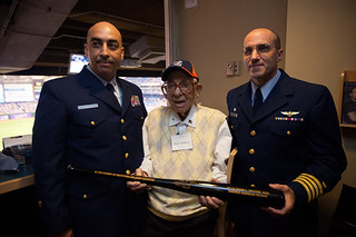 Master Chief Petty Officer Michael Aviles and Capt. John Turner present Frank Spatuzzi with a gift. Photo courtesy of Coast Guard Master Chief Petty Officer Michael Aviles.