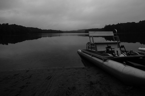 714mm beach boat brightonstatepark clouds em5 forest landscape monochrome pedal pond sand trees water woods brighton vermont unitedstates