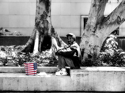 A homeless man at the sitting outside the Court building on Grand Ave by rebeccadru
