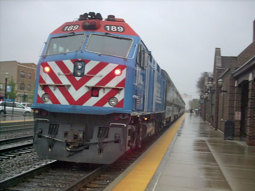 Eastbound Metra local boarding and disembarking passengers in the rain.  La Grange Illinois.  April 2007. by Eddie from Chicago