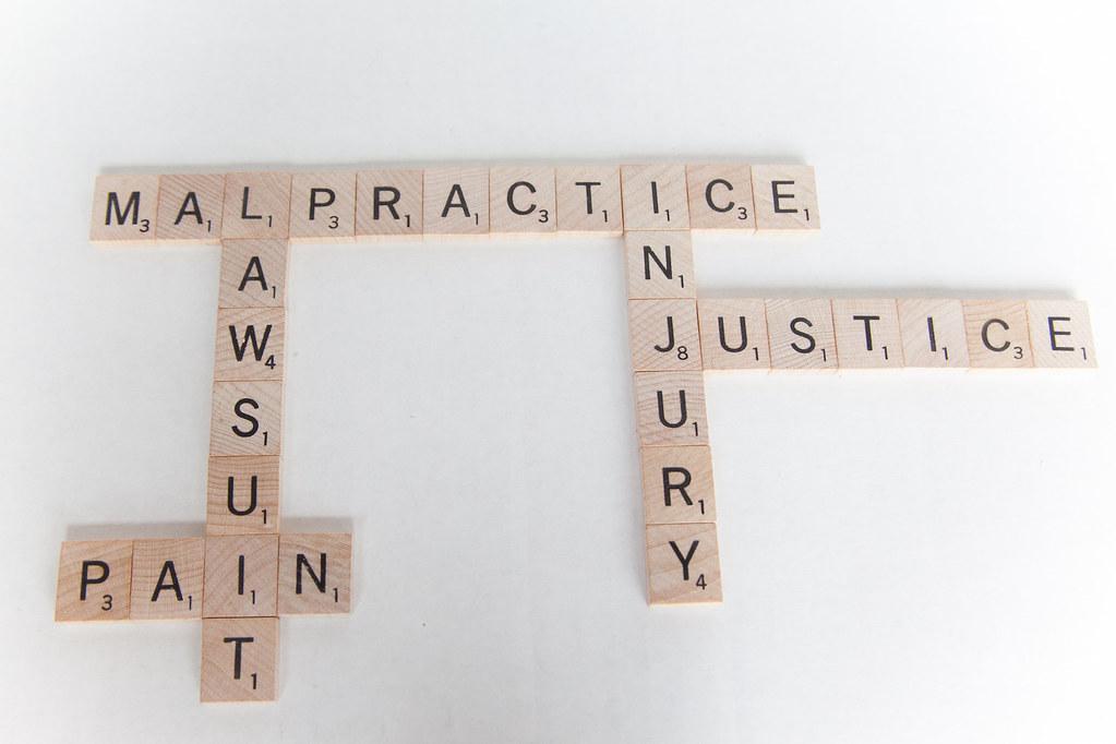 Malpractice Lawsuit, Injury - Scrabble