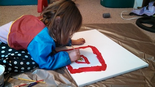 Lily painting the zoo