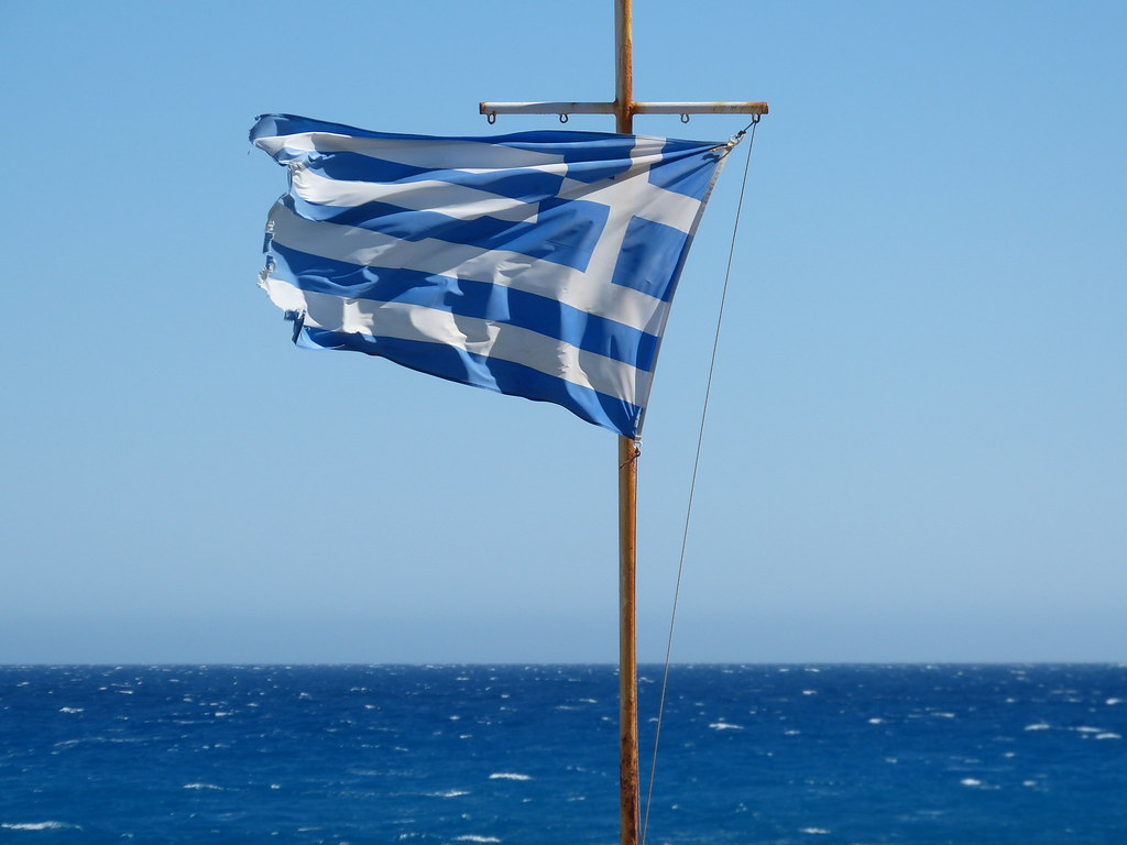 Flag looking out at the Lybian sea in Crete