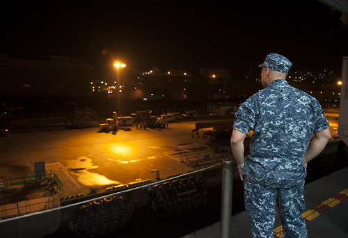 A Sailor observe USS Bonhomme Richard approaching Commander, Fleet Activities Sasebo pier.