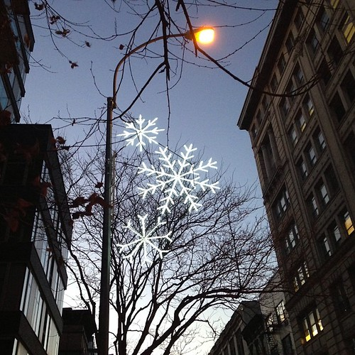 Snowflake lights on lamp posts. Spring Street #nyc