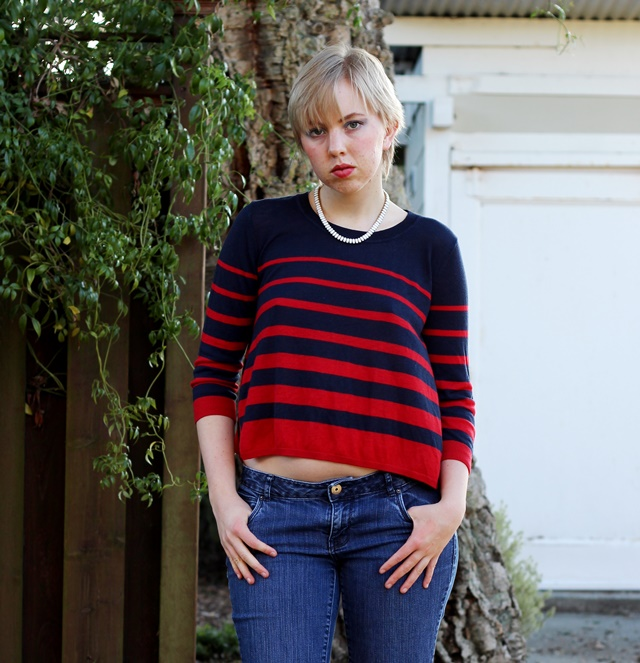 navy blue and red striped sweater with jeans