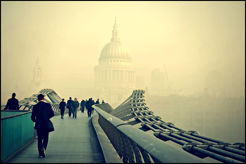 People walking to work in the early-morning London fog