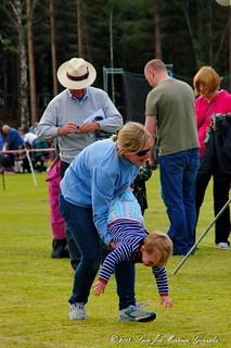 Nethy Bridge: Highland Games:Children'events: wheelbarrow race serie: a little trick