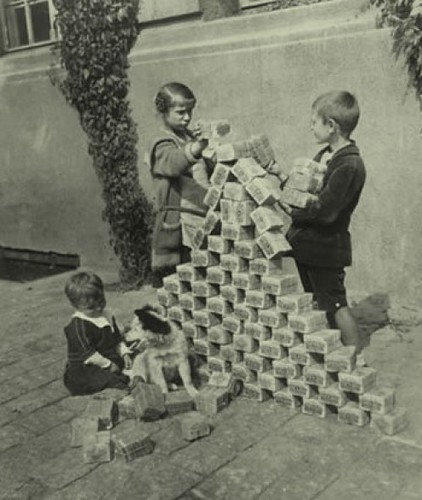 Children playing with German inflation money