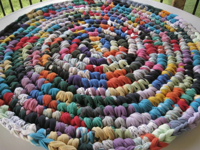 A Crochet Rag Rug Of Many Colors From Recycled Fabrics