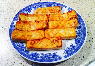 Seared soft tofu in vegan worcestershire