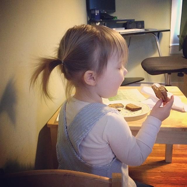 Eating toast.