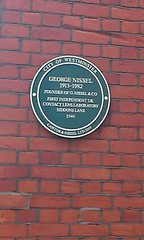 Photo of George Nissel green plaque