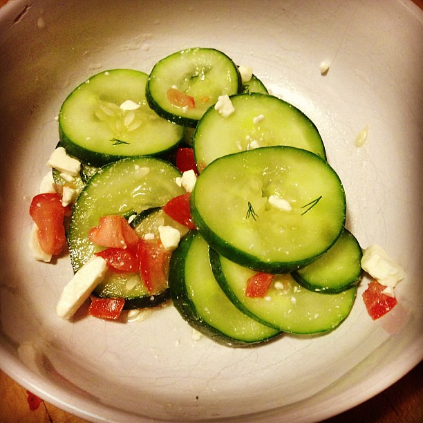 Cucumber, tomatoes, feta, dill, and a bit of vinegar, salt, and sugar.